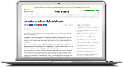 laptop with real estate article