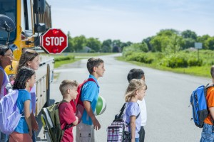 kids crossing school bus
