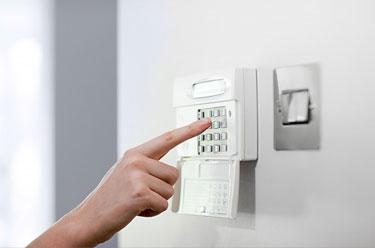 finger pressing alarm pad