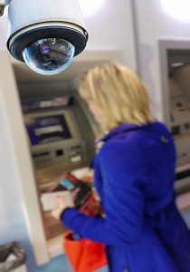 closeup on security CCTV camera or surveillance system in local cash dispenser