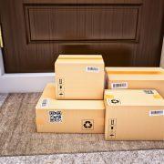 Cardboard boxes on the door mat near the entrance door