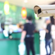 Security camera on blurred background of people in the cafe, concept of security and safety, protect your business