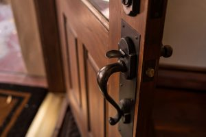 Image of front door open, signifying home burglary, home security risk